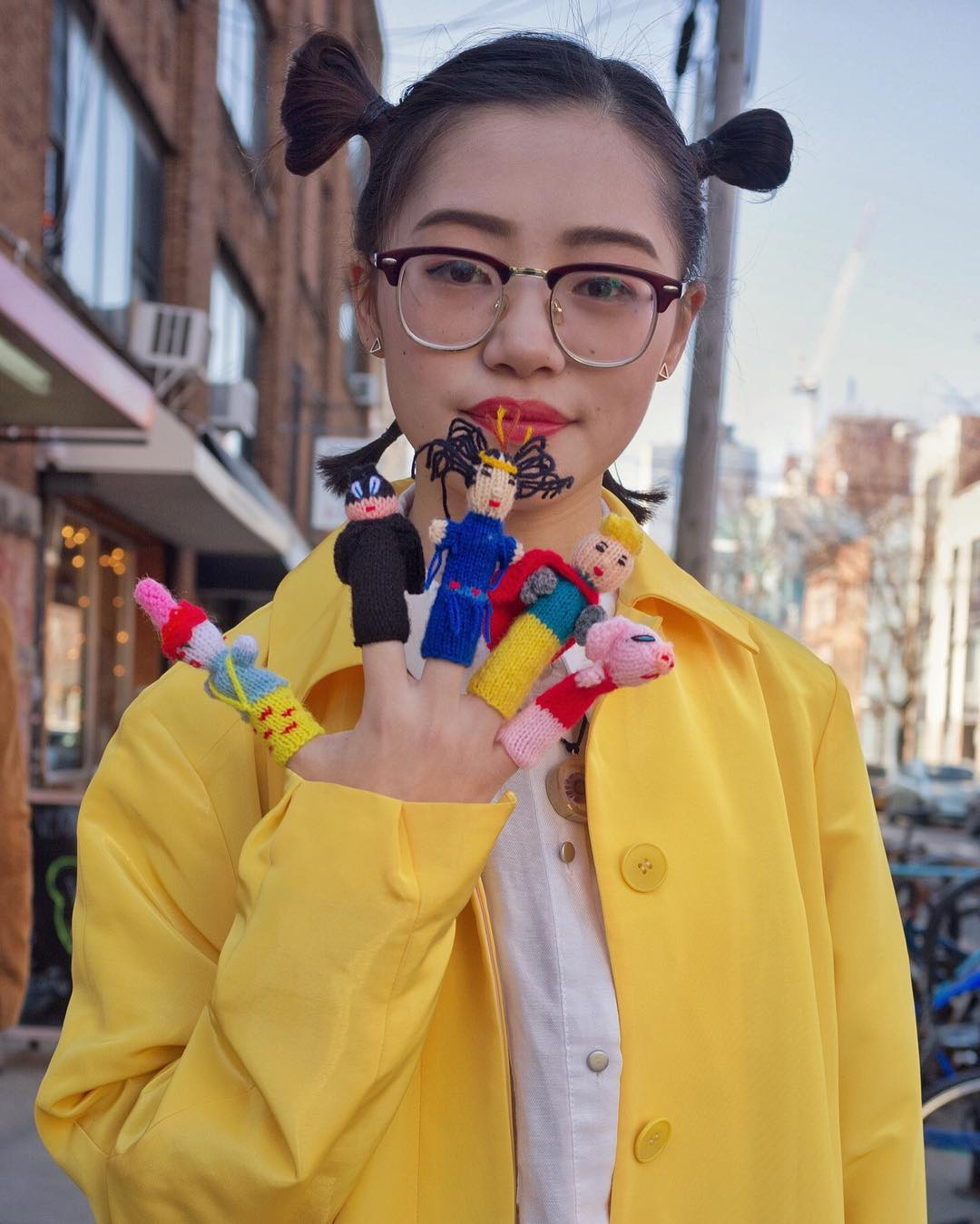 I was hanging with some photographer friends in Williamsburg and saw Jaluli and her beautiful yellow coat! She was also buying finger puppets which if