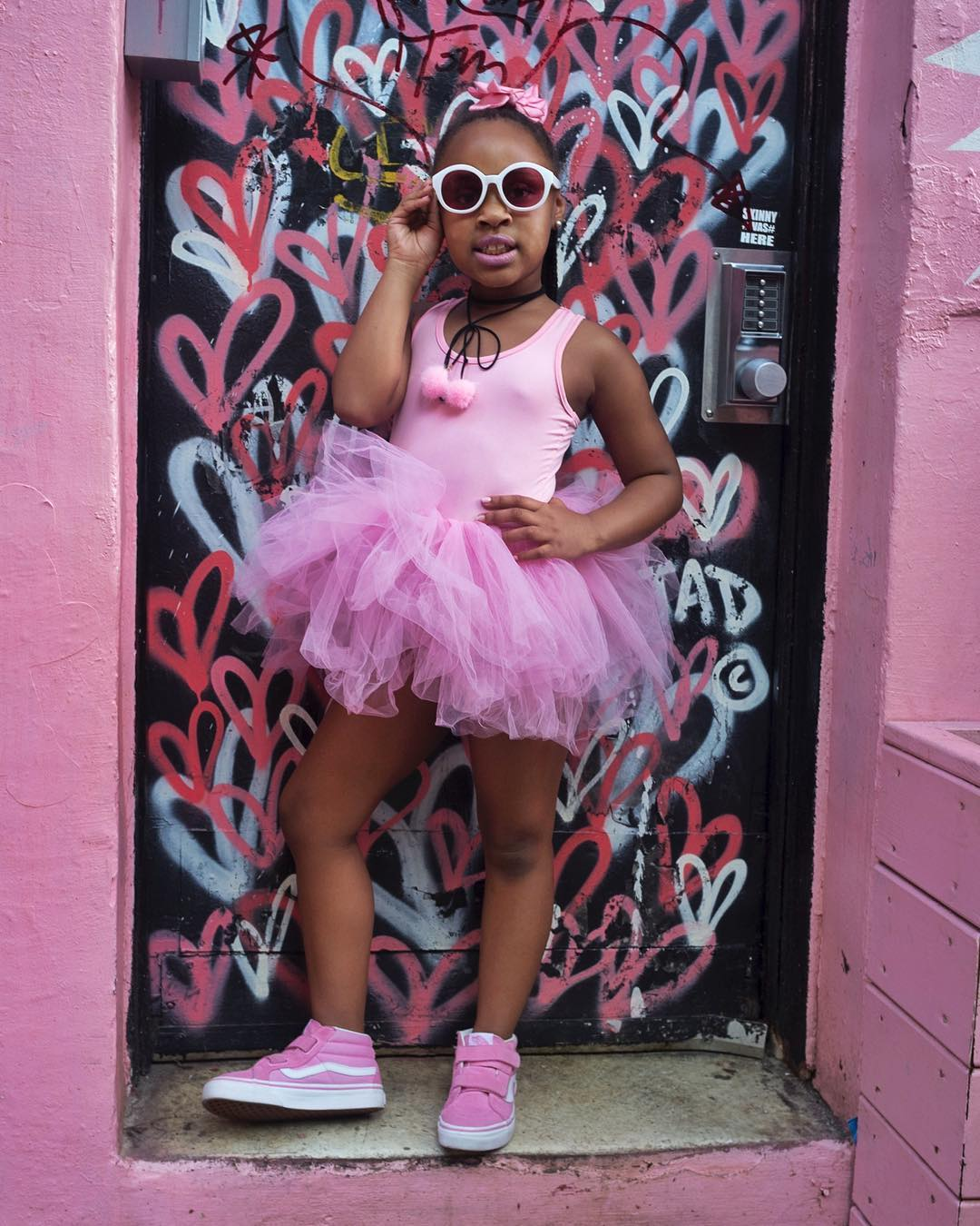 I ran into this little girl posed exactly like this on this heart wall. Talk about luck!